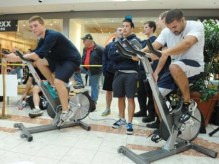 Lambton College students Joel Terhaerdt and Kyle Carneiro knuckle down on bikes instead of books, adding miles to their team's total.
