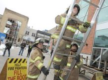 Firefighters climb to their home for the next 72 hours.
