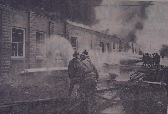 Firemen battle the blaze along the west wall of the White factory. Workers said the fire apparently started in a storage area.