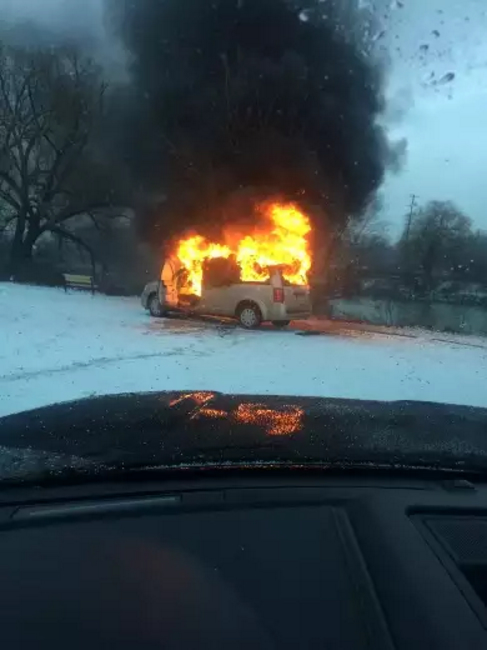 Van fully engulfed in flames