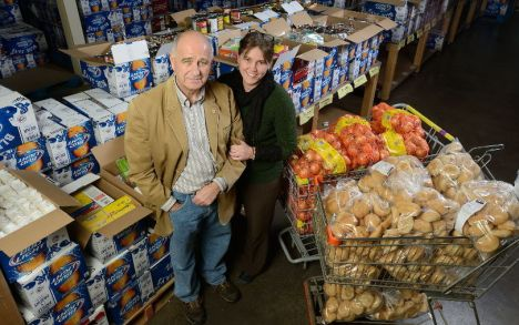Glen Pearson and Jane Roy at the London Food Bank which is marking its 30th year in London. (MORRIS LAMONT, The London Free Press)