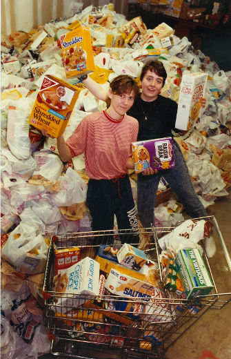Jane Roy of The London Food Bank and Jennifer Hemming a volunteer student with the Saunders Serve program at Saunders S.S. help with sorting of food donations from several malls after the Breakfast For Kids food drive ended. (October 6, 1990)
