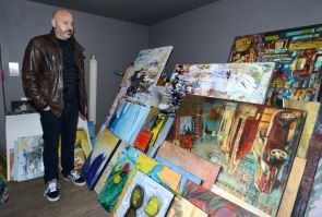 Mike Manuel, owner of the London Music Hall, look over pieces of art rescued from a fire at Artisan's Alley at 430 Richmond St. in London on Wednesday, March 29, 2017. The art was temporarily stored at the Music Hall which is situated behind the gallery. Firefighters were called to a blaze at the downtown building about 4:45 a.m. (MORRIS LAMONT, The London Free Press)