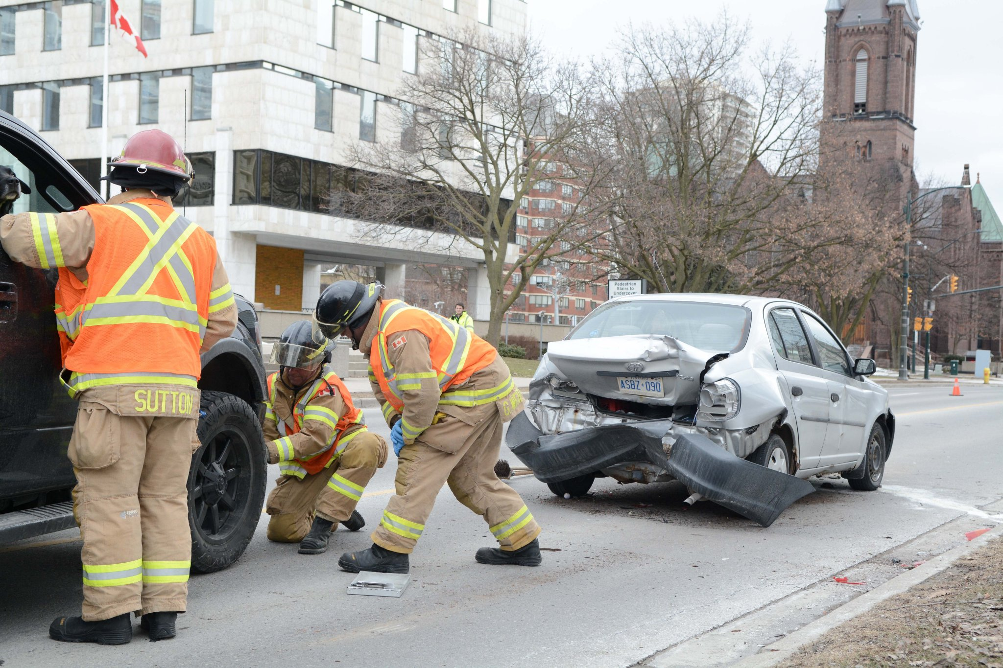 Firefighters help at the scene of a collision on Wellington