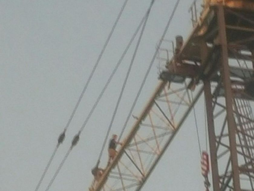 Man climbs to top of construction crane in downtown London