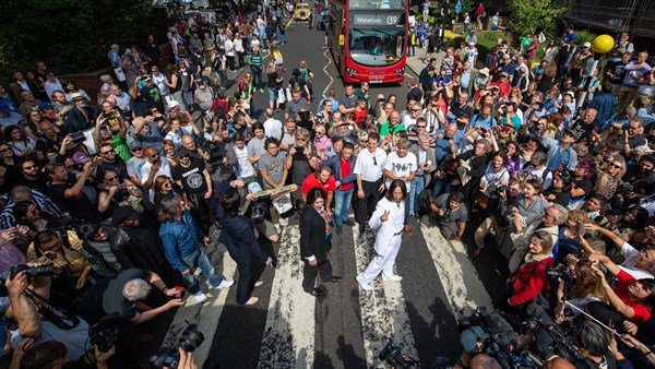 Beatles fans flock to Abbey Road to commemorate 50th anniversary of album.