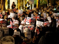 Hong Kong protesters wait outside British Consulate asking for support
