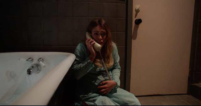 Sharon on telephone