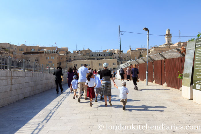 A young family walking to the Western Wall Jerusalem