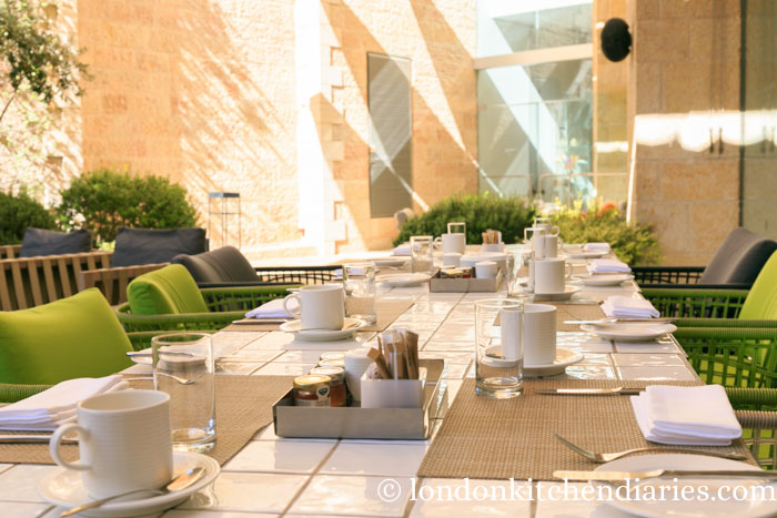 Nicely laid outside tables at Mamilla Hotel Jerusalem