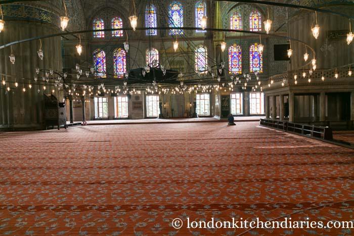 Vast interior prayer hall of the Blue Mosque