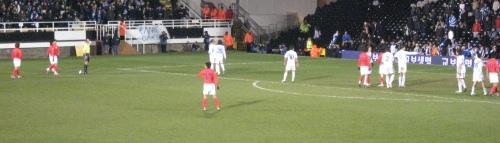 South Korea prepare to take the winning free kick