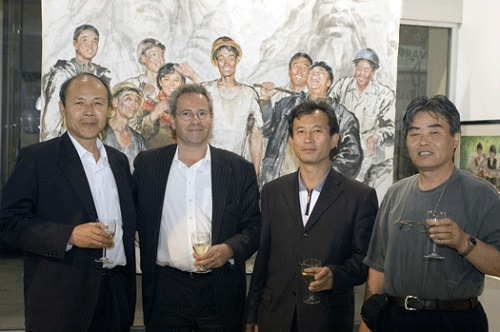 The artists with David Heather in front of Kim Song Min's 'Sculpture Workers'