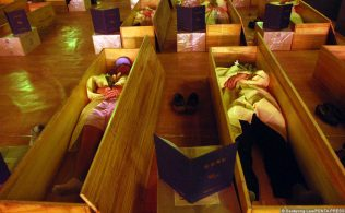 Course members get into their coffins and a flower is laid on each persons chest