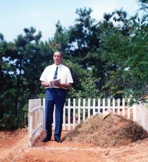 Flt Lt Desmond Hinton's brother David visits his grave