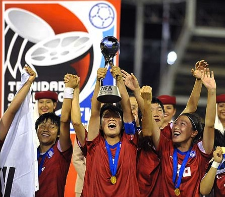 Korean under-17 women footballers celebrate world cup victory over Japan