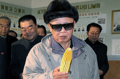 Kim Jong-il looking at corn