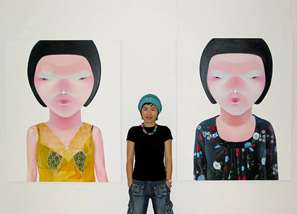 Lee So-yeun poses with two self portraits