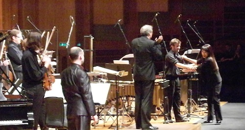 Chin congratulates percussionist Owen Gunnell after the Double Concerto