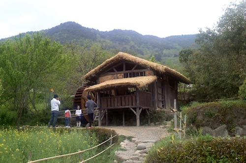 Tourists pose in front of the mill in the SBS T'oji TV set