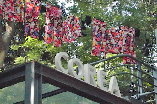 Angel Soldier uniforms hanging out to dry outside the Korean pavilion