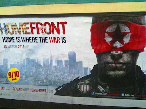 An advertisement for Homefront at Hammersmith tube station, London, May 2011