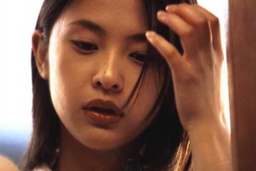 Aya, who becomes Asako to earn enough money for her suicide bid
