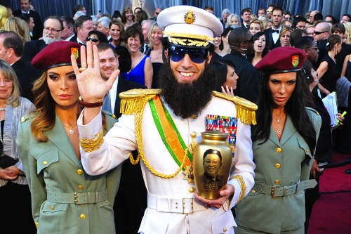 Sacha Baron Cohen with his two-strong Pleasure Squad and Kim Jong-il's ashes