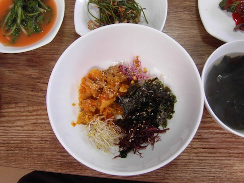 Meonggae  bibimbap before mixing in the rice