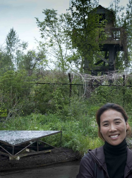 Hwang Jihae in front of her nearly-finished garden