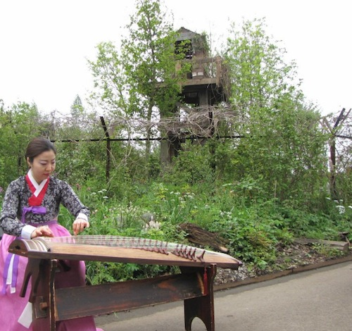 Jung Ji-eun performs on the Kayageum to celebrate the garden's opening