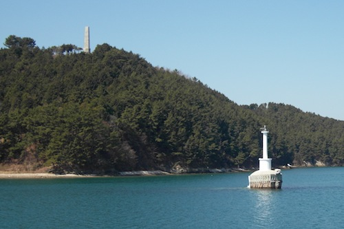 A turtle-ship lighthouse and a beacon on the hill above guard the entrance to Hansando harbour