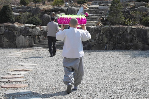 Carrying lanterns to the temple after lunch