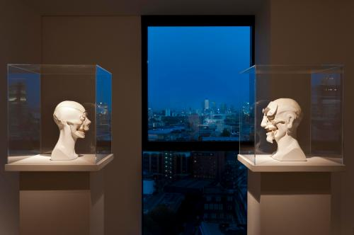 Lee Hyung-koo: Face Trace. Beyond, the towers of Canary Wharf. Image courtesy House of the Nobleman