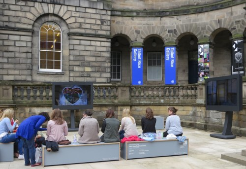 Edinburgh University students have lunch and watch Nam June Paik videos