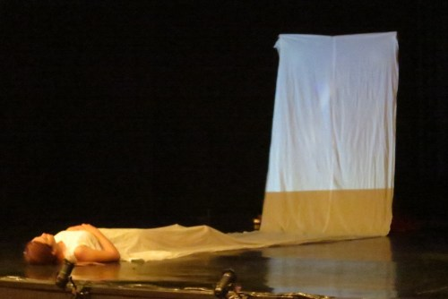 The play opens to reveal a sleeping girl having a nightmare