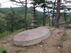 Some of the Seven Stars (circular rocks) and their seven-storeyed stone pagoda