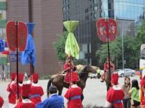 The Sajik Daeje procession Leaves the Deoksu Palace, crossing the road to Seoul Plaza