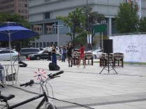 Singers in front of Gwanghwamun entertain the tourists and shoppers