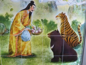 Hwanung gives mugwort and garlic to the tiger and bear in the Korean foundation myth