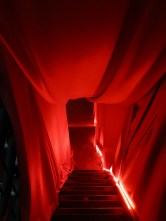 The stairs down to the opium den