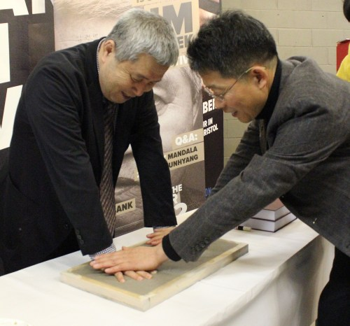Im Kwon-taek leaves a handprint for the KCC's film archive