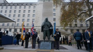 War veterans beside the memorial
