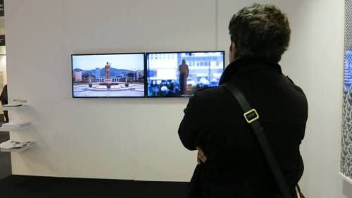 Installation view of two of Mioon's video works