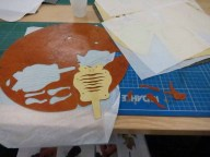 Popping the shapes out of the pre-cut sheets of flooring paper