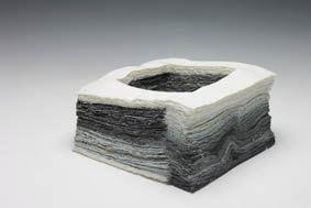 Jong Jin Park - Artistic stratum | 2014 | 18X18X9cm | Porcelain, Black stain | Brushing clay slip on 600 tissues | 1280 ℃ firing