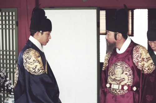 Crown Prince Sado (Yoo Ah-in, left) is berated by his father King Yeongjo.