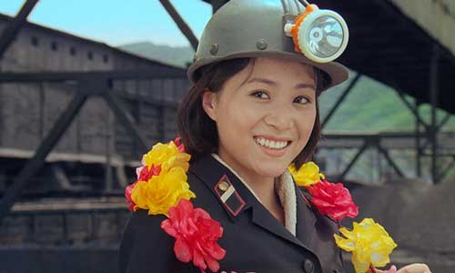 Comrade Kim Yong-Mi played by Han Jong Sim