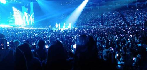 BTS and the audience bathed in the blue light of the ARMY bombs