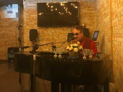 Lee Yong-bok performing at his cafe
